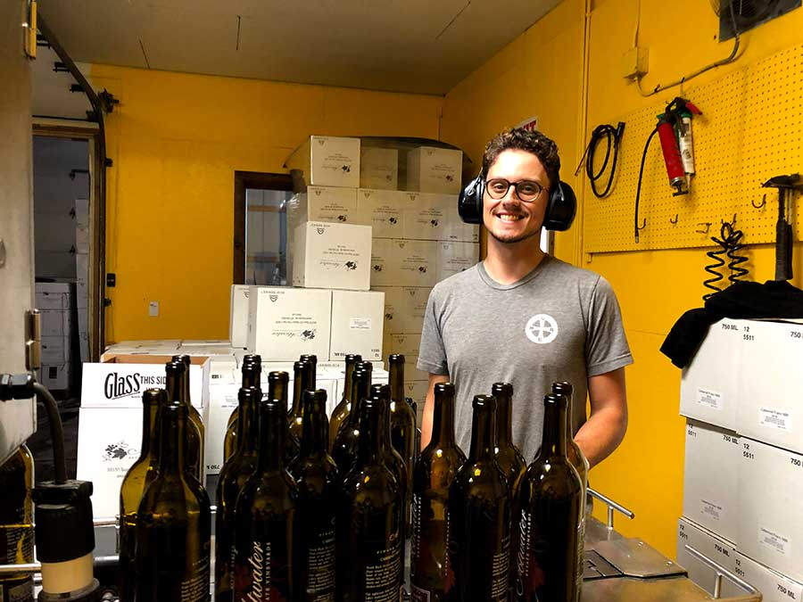 Wes Andrew, harvest intern, bottling wine
