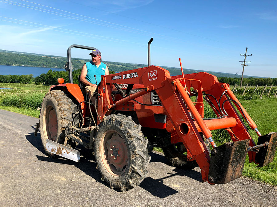 Vineyard worker Mike Betts on a tractor.
